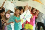 Elementary school students cheer on the graduating seniors