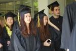 Graduates walk through the school on their final day