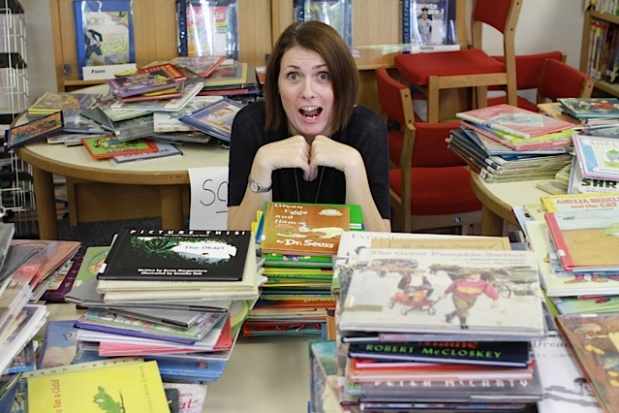 Bethany Fields, the Elementary School Library Assistant shows us how the library team is resorting books by genre