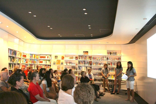 Elicia, Michelle and Emma giving a presentation in the high school library