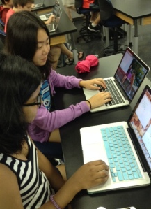 """It's rewarding because after you finish writing a program and you run it you know if it works or not. If it works you feel elated with what you accomplished."" - Lauren Seniguchi. (On the right with Ashita Kumar working on writing a Python lab, both 9th grade.)"