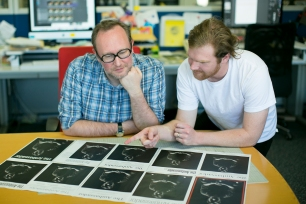Matt and Simon review cover design options.